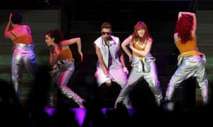Bieber fever hits Cape Town as the teen idol plays to a sold-out audience at the Cape Town Stadium in South Africa on his Believe tour.