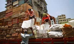 Workers from a transport company load packages on to a truck at a market in Mumbai. India's April trade deficit leapt to the equivalent of £11.58bn, a trade ministry official said, increasing concerns about the current account deficit in Asia's third largest economy.