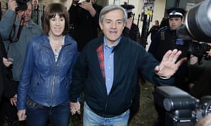 Chris Huhne centre, and his partner Carina Trimingham arrive at his home in London following his release from jail.