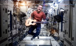 Colonel Chris Hadfield handed over command of the International Space Station yesterday, and to mark the occasion posted a remarkable performance of David Bowie's Space Oddity in which he and his guitar float around the space station in a most peculiar way....and he's quite a talent as you can hear.