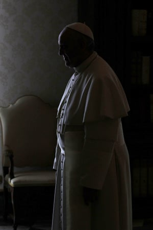 A beautiful picture of Pope Francis, silhouetted as he waits for the Colombian president, Juan Manuel Santos, before their meeting in the pontiff's private library at the Vatican.