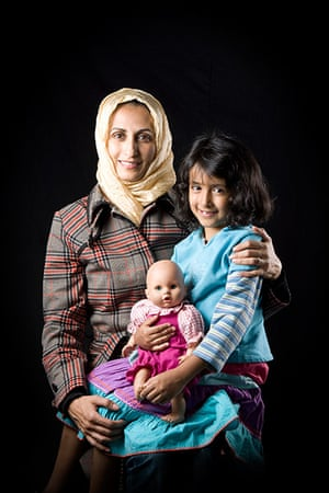 big picture - hijab: middle eastern woman with headscarf and child and doll