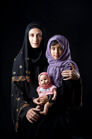 big picture - hijab: middle eastern woman with long headscarf and child and doll
