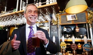 Ukip leader Nigel Farage grabs a pint in the Marquis of Granby pub in Westminster