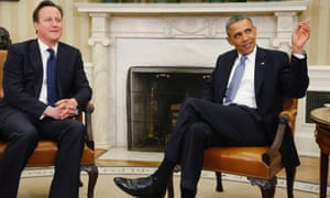 U.S. President Barack Obama (R) reminds reporters that they've been asked to leave, as they start asking questions as he sits down to a meeting with Britain's Prime Minister David Cameron (L), in the Oval Office at the White House.