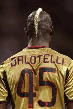 Mario Balotelli of AC Milan, with hair beautifully matching that gold strip.