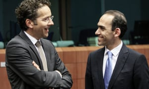 Eurogroup President Dutch Finance Minister Jeroen Dijsselbloem (L) chats with Cyprus finance minister Haris Georgiades at the start of a Eurogroup Finance Ministers meeting at the European Council headquarters in Brussels, Belgium, 13 May 2013.  EPA/OLIVIER HOSLET