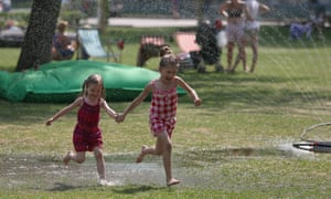 Making a splash, these children cool off in water sprinklers in a park in Moscow, Russia, where the temperature has risen to a scorching 29C, breaking all previous records for this day of the year.