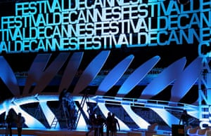 Cannes preparation : Workers install a giant Palme d'Or in the Grand Theatre Lumiere ahead of th