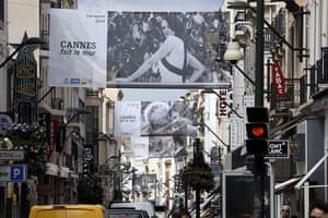 Cannes preparation : Pictures of film stars advertise the festival above the streets in Cannes