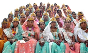 Brides from the Pal community wait to take part in a mass marriage ceremony during the Akshaya Tritiya festival in Bhopal, India. This day of the festival is thought to be the most sacred for marriage according to Hindu belief. Photograph: Sanjeev Gupta/EPA