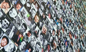 Photographs of journalists killed in the line of work are seen on the Journalists' Memorial at the Newseum in Washington, DC. Some 87 journalists from around the world, who died while covering the news in 2012 have been commemorated today and their names and photos added to the memorial.
