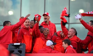 They are the champions, they are ....: Manchester United players celebrate on board the champions' bus outside Old Trafford Stadium in Manchester, north west England, as the team begins their parade to celebrate winning the Premier League. Photograph: Paul Ellis/AFP/Getty Images