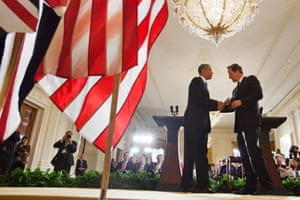 US President Barack Obama shakes hands with Prime Minister David Cameron at the conclusion of their joint news conference, in the East Room of the White House in Washington. Photograph: Jacquelyn Martin/AP