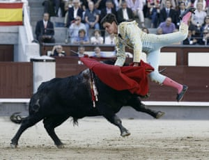 Spanish bullfighter David Galvan is gored by his first bull of the evening during the fifth bullfighting of the San Isidro Feast held at Las Ventas' bullring in Madrid, Spain. Photograph: Ballesteros/EPA