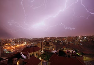 A spectacular thunderstorm lights the skyline in Amman, Jordan, as temperatures dropped to 20 degrees Celsius (68 degrees Fahrenheit).