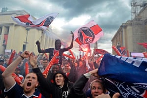 Paris Saint-Germain (PSG) supporters shout slogans before clashing with French riot police during a ceremony at Trocadero to celebrate PSG winning the French League 1 soccer title in Paris, France.