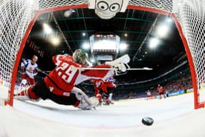 Austria's goalie Bernhard Starkbaum concedes a goal to Russia during their 2013 IIHF Ice Hockey World Championship preliminary round match at the Hartwall Arena in Helsinki. Finland.