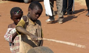 A Zambian boy plays with a used tyre in Livingstone