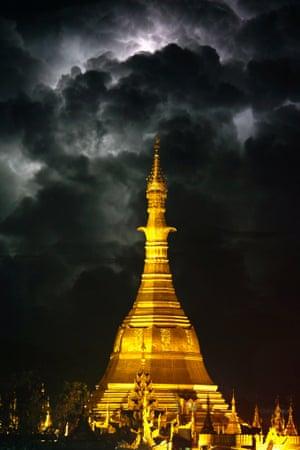 Lightning is seen over the glowing Sule pagoda in Rangoon, Burma.