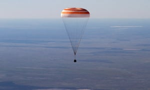 The Russian Soyuz space capsule, carrying US astronaut Thomas Marshburn, Russian cosmonaut Roman Romanenko and Canadian astronaut Chris Hadfield, descends about 90 miles south-east of the town of Dzhezkazgan in central Kazakhstan, this morning.