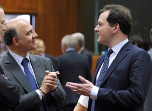 French minister of  Economy, Finances and Foreign Trade  Pierre Moscovici and British Chancellor of the Exchequer  George Osborne  (LtR) talk prior to an Economic and Financial Affairs meeting on May 14, 2013 at the EU Headquarters in Brussels