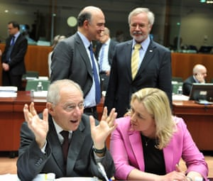 German Finance Minister Wolfgang Schaeuble and Finnish Finance Minister Jutta Urpilainen talk in front of (from L, background) French minister of  Economy, Finances and Foreign Trade Pierre Moscovici and European Investment Bank President Werner Hoyer prior to an Economic and Financial Affairs meeting on May 14, 2013 at the EU Headquarters in Brussels.
