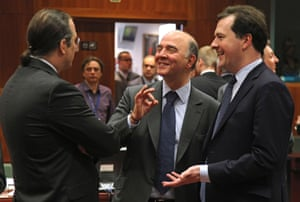 French Finance Minister Pierre Moscovici, center, talks with Swedish Finance Minister Anders Borg, left, and British Chancellor of the Exchequer George Osborne, during the EU finance ministers meeting, at the European Council building in Brussels, Tuesday, May 14, 2013.