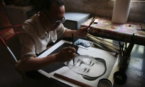 Chinese farmer Yang Chuanye makes a charcoal portrait of Chairman Mao Zedong, in Jishan county, Shanxi province. Yang, 62, started making charcoal paintings when he was 20. Apart from painting portraits of former and current Chinese leaders, Yang also paints portraits of deceased people from his county.