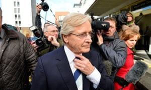British television actor Bill Roache walks past reporters as he arrives at Preston magistrates court. Roache, known for his longstanding role as the character Ken Barlow in the soap opera Coronation Street, made his first appearance in court where he faces charges of two counts of rape involving a 15-year-old girl in 1967.