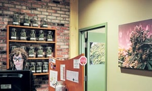 A Denver Relief's 'budtender' rings up a sale