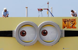 Cannes preperations: A Despicable Me 2 poster is installed on the Carlton Hotel pier