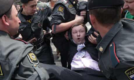 Russian police detain activist Nikolai Alexeyev during an unauthorised gay pride parade in Moscow
