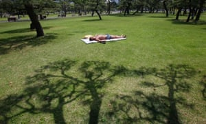 And relax: a man takes a nap in a park on a warm day in Tokyo.