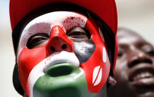 A protester wearing a mask with the colours of the Kenyan flag participates in a demonstration against lawmakers' salary demands outside the parliament buildings in the capital Nairobi.