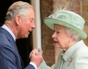 The Queen is greeted by the Prince of Wales as she arrives at the Chapel Royal, at St James's Palace, central London, to attend a service for members of the Order of Merit.