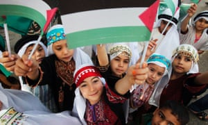 Palestinian children wearing traditional clothes wave their national flags as they take part in a march to mark the 65th anniversary of Nakba, at Ain al-Hilweh refugee camp near Sidon, southern Lebanon. Palestinians will mark Nakba (Catastrophe) on 15 May to commemorate the expulsion or fleeing of hundreds of thousands of their brethren during the war that led to the founding of Israel in 1948.