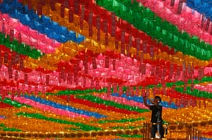 A man attaches the name tag of a Buddhist donor to a lantern ahead of Buddha's upcoming birthday on 17 May at the Jogye temple in Seoul, South Korea.