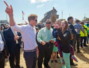 Prince Harry (L) and New Jersey Governor Chris Christie (C) pose with the Bowden family on their empty lot in Mantoloking, New Jersey, USA. The governor and the prince are inspecting areas of Ocean County - Mantoloking and Seaside Heights - that suffered extensive damage during Hurricane Sandy.