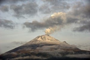 """The Popocatepetl Volcano, Mexico's second highest peak just 55 km southeast of Mexico City, is seen from Santiago Xalitxintla, in Puebla, spewing a cloud of ash and smoke. The National Disaster Prevention Centre raised the alert level on Sunday to """"yellow phase three""""."""
