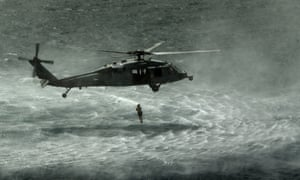 A US Seahawk helicopter drops a diver in the water during a drill to destroy mines by placing explosives on them, at an undisclosed location in the Arabian Sea. Today is the second day of the biggest mine countermeasures exercise - featuring the US Navy and 40 other nations - in the Arabian Gulf.