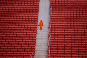 A worker is seen at the Nacional stadium in Brasilia, Brasil. Photograph: Fernando Bizerra Jr./EPA