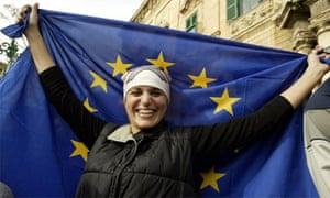 A young woman holding the EU flag