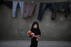 This sweet portrait of six year old Palestinian refugee girl Asmaa Nadem deserves to be seen, as she smiles in Jabaliya Refugee camp, Gaza Strip. Palestinians mark the 65th anniversary of Nakba Day (Day of the Catastrophe) on 15 May to commemorate their displacement after the Israeli Declaration of Independence in 1948. Photograph: Ali Ali/EPA