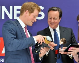 Oh look mine's got a beret: Prince Harry and David Cameron are presented with dolls by 'Makielab' company co-founder Jo Roach of themselves during part of a UK business campaign called 'GREAT' at the Milk Studios, Manhattan, New York. Photograph: Bruce Adams/Daily Mail/PA