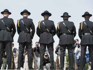 People photograph members of the Dekalb County Police during the 11th annual honor guard competition on Capitol Hill in Washington, DC. The competition was held as part of the 2013 Police Week.