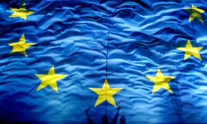 FILE - In this Monday, Jan. 1, 2012 file photo, cheering Romanians cast shadows on a giant European Union  flag during new year celebrations for Romania's accesion in the EU in Bucharest Romania.