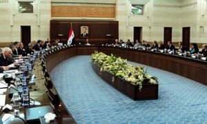 A handout picture made available by the official Syrian Arab News Agency (Sana) on 14 May 2013 shows Syrian PM Wael Halqi (centre) heading the weekly meeting of the ministers' council in Damascus.
