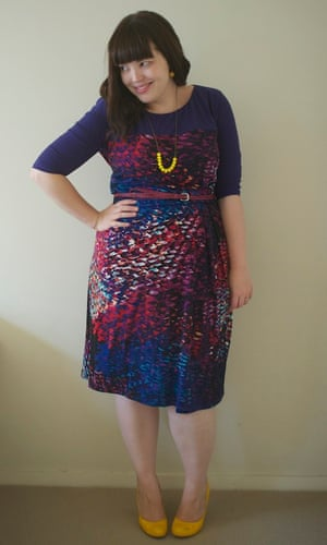 Woman with hand on hip wearing multicoloured dress