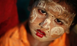 A Rohingya Muslim child wearing traditional make-up outside a tent at a camp for people displaced by violence, near Sittwe, Burma.